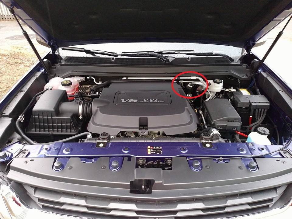 1) in the engine bay, on the firewall, between the engine and the brake  fluid reservoir is the grommet where you want to cut into: